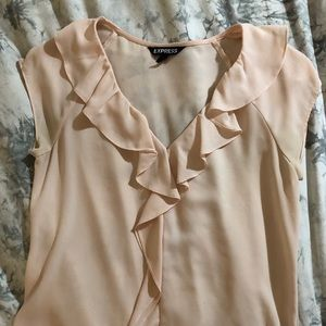 Blush pink blouse.